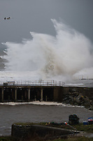 "Pictured: Waves crash against the seaside town of Aberystwyth, Wales, UK. Saturday 21 October 2017<br /> Re: Coastal parts of the UK is facing winds of up to 70mph as Storm Brian causes roads to close and public transport to be cancelled.<br /> Roads in Aberystwyth's seafront and at nearby Aberaeron, Wales are shut on Saturday morning as a yellow ""be aware"" Met Office warning is in place.<br /> Seven flood warnings have been issued for the west Wales coast."