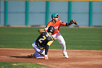 Norman Leon (2) of Evergreen Valley High School in San Jose, California waits for a throw as Isaiah Aguilar (2) of Alice High School in Alice, Texas slides into second base during the Baseball Factory All-America Pre-Season Tournament, powered by Under Armour, on January 13, 2018 at Sloan Park Complex in Mesa, Arizona.  (Zachary Lucy/Four Seam Images)