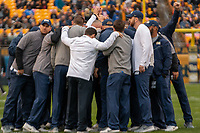 Members of the Pitt football coaching staff huddle before the game. The Pitt Panthers football team defeated the Duke Blue Devils 54-45 on November 10, 2018 at Heinz Field, Pittsburgh, Pennsylvania.