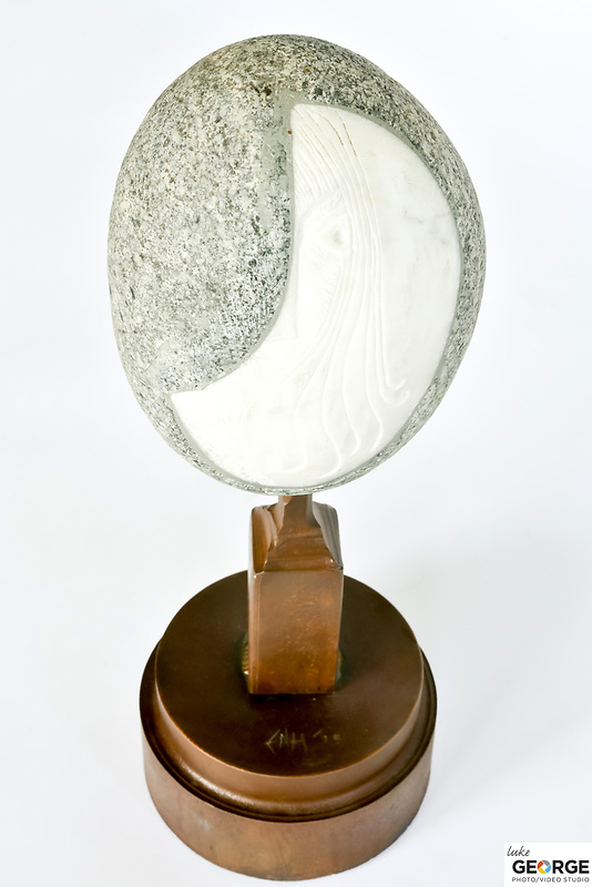 Title: Girl With The Skinny Lips<br /> Materials: Granite, Marble and Steel<br /> Size: 16Tx6x6<br /> Price: Available on Request