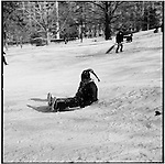 During a snow day children and their parents go to a big hill in Manhattan's Central Park for some sledding.
