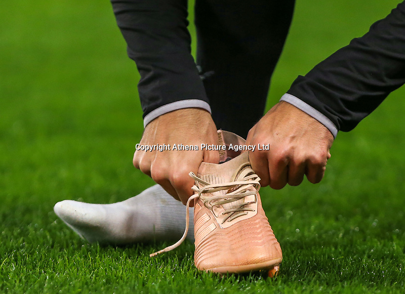 Yevhen Shakhov of PAOK changes his boots during training and press conference at Stamford Bridge, London