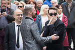 © Joel Goodman - 07973 332324 . 30/06/2017 . Stockport , UK . Family and friends arrive outside the Town Hall . The funeral of Martyn Hett at Stockport Town Hall . Martyn Hett was 29 years old when he was one of 22 people killed on 22 May 2017 in a murderous terrorist bombing committed by Salman Abedi, after an Ariana Grande concert at the Manchester Arena . Photo credit : Joel Goodman