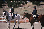 YOUNG WOMEN COMPETE IN HORSE SHOW