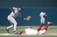 Enrique Wilson of the New York Yankees is late with the tag on a sliding Darin Erstad of the Los Angeles Angels during a 2002 MLB season game at Angel Stadium, in Anaheim, California. (Larry Goren/Four Seam Images)
