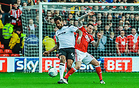 Derby County's midfielder Tom Huddlestone (44) is tackled by Nottingham Forest's forward Lee Tomlin (15) during the Sky Bet Championship match between Nottingham Forest and Derby County at the City Ground, Nottingham, England on 10 March 2018. Photo by Stephen Buckley / PRiME Media Images.