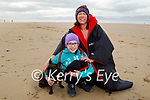 Mairead and Orla Kane with Lola the dog enjoying a stroll in Banna beach on Sunday.