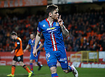 Greg Tansey celebrates as he nets from the penalty spot to put Inverness ahead