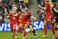 Canada forward Melissa Tancredi (14) shoots on goal.