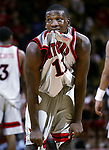 """""""THIS BITES""""<br /> -On Sun Jan 12,2003<br /> -Despite being the game's high scorer at 20 points Rutgers # 11 Jerome Coleman bites his shirt out of frustration as Rutgers loses to Pittsburgh at the Louis Brown Athletic Center, Piscataway."""