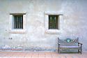 Windows and painted bench at mission at San Juan Capistrano California