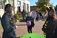 Janelle Jessen/Herald-Leader<br /> Patricia Rubio (left) and Allysa Cochran (right) of First Employment pass out candy to Piper Williams on Thursday during the annual Downtown Trick or Treat.
