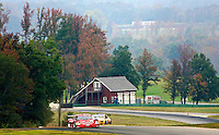 A pair of cars races through the Virginia coountryside during the Grand-Am Rolex Series test at Virginia International Raceway, Alton, VA , October 2010. (Photo by Brian Cleary/www.bcpix.com)
