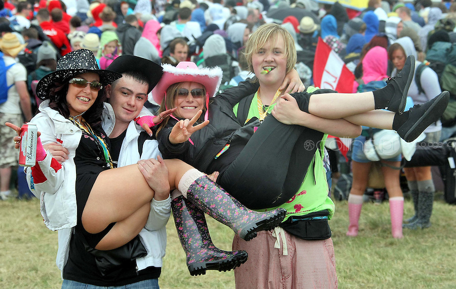 08/07/'10 Samantha Clince, Ronan Condon, Anita Gibbons and Kevin Power all from Kildare pictured arriving at Punchestown, Co. Kildare this evening for the start of the Oxegen Festival 2010...Picture Colin Keegan, Collins, Dublin