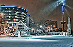 Snowy night at Riverscape in Dayton Ohio. Caresource building showing in the background.