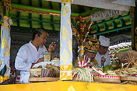 Jatiluwih, Bali, Indonesia.  Hindu Priest Praying over Offerings, Luhur Bhujangga Waisnawa Hindu Temple.