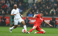 Andre Ayew of Swansea City is tackled by Dejan Lovren of Liverpool during the Barclays Premier League match between Swansea City and Liverpool played at the Liberty Stadium, Swansea on 1st May 2016
