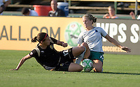 Christine Sinclair (left) and Elise Weber (right) slide for the ball. FC Gold Pride tied the St. Louis Athletica 1-1 at Buck Shaw Stadium in Santa Clara, California on August 9, 2009.