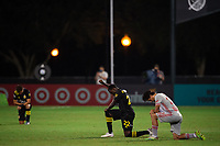 LAKE BUENA VISTA, FL - JULY 16: Derrick Etienne #22 of the Columbus Crew SC before the game during a game between New York Red Bulls and Columbus Crew at Wide World of Sports on July 16, 2020 in Lake Buena Vista, Florida.
