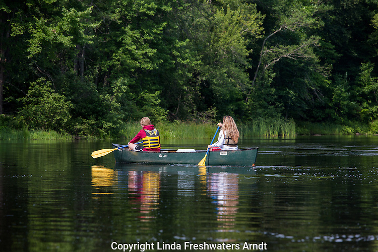 Mother and son paddling down the Flambeau River