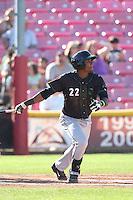 Franchy Cordero #22 of the Eugene Emeralds bats against the Salem-Keizer Volcanoes at Volcanoes Stadium on July 27, 2014 in Keizer, Oregon. Salem-Keizer defeated Eugene, 9-1. (Larry Goren/Four Seam Images)