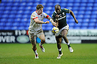 David Strettle of Saracens races against Topsy Ojo of London Irish during the Aviva Premiership match between London Irish and Saracens at the Madejski Stadium on Saturday 9th February 2013 (Photo by Rob Munro)