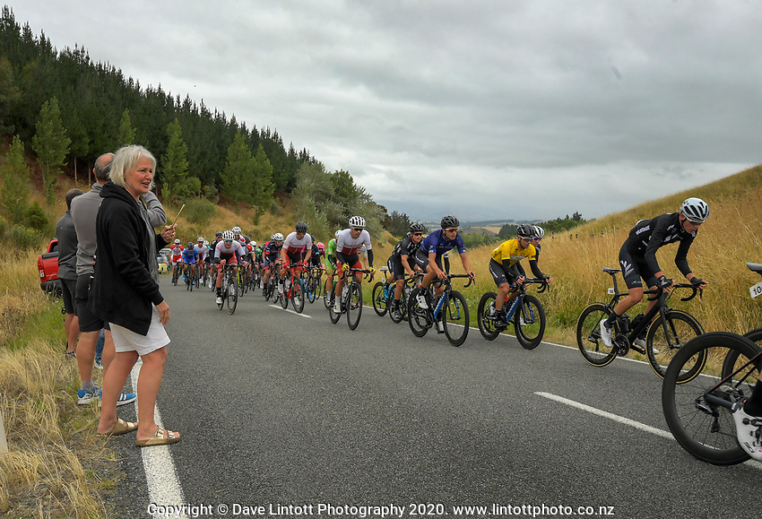 The peloton passes over the top of Millars Road on the first circuit during stage two of the NZ Cycle Classic UCI Oceania Tour (Gladstone circuit) in Wairarapa, New Zealand on Thursday, 16 January 2020. Photo: Dave Lintott / lintottphoto.co.nz