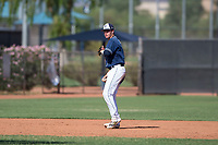San Diego Padres shortstop Jarryd Dale (5) prepares to make a throw to first base during an Instructional League game against the Milwaukee Brewers at Peoria Sports Complex on September 21, 2018 in Peoria, Arizona. (Zachary Lucy/Four Seam Images)