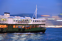 Star Ferry on Victoria Harbour at dusk, Hong Kong SAR, China, Asia