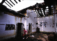 A house demolished by the Birth control unit in south china's guangdong Province. The house was destroyed by thugs controlled by the Birth Control Unit when the occupant had too many children and was unable to pay a fine. It is common that after animals and furniture is stolen a roof of a house is smashed. <br /> <br /> PHOTO BY RICHARD JONES/SINOPIX