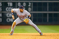 Detroit Tigers third baseman Miguel Cabrera (24) prepares to throw the ball to second base during the MLB baseball game against the Houston Astros on May 3, 2013 at Minute Maid Park in Houston, Texas. Detroit defeated Houston 4-3. (Andrew Woolley/Four Seam Images).