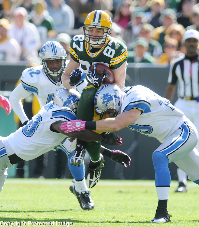 Green Bay Packers' Jordy Nelson is sandwiched between Detroit Lions Isaiah Ekejiuba, left, and John Wendling during a kickoff return in the second quarter of the game at Lambeau Field in Green Bay, Wis., on Oct. 3, 2010.