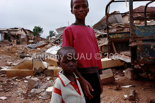 Guekedou, Guinea.April 2001..Childern in the streets of Guekedou ... a town that was attacked by Sierra Leone rebels then bombed by the Guinean military in January. The attacks scattered hundreds of families and separated children from parents throughout the region.