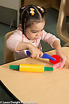 Education Preschool Child care two year old program girl playing with play dough