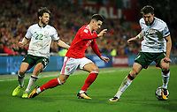 Tom Lawrence of Wales -\runs past Harry Arter (L) and James McCarthy of Ireland (R) during the FIFA World Cup Qualifier Group D match between Wales and Republic of Ireland at The Cardiff City Stadium, Wales, UK. Monday 09 October 2017