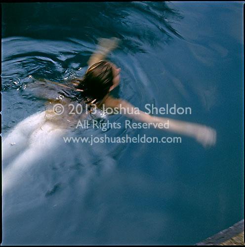 Young woman swimming in swimming pool