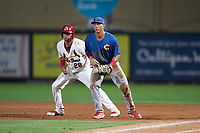 Clearwater Threshers first baseman Matt Kroon (45) holds Dennis Ortega (28) on during a Florida State League game against the Palm Beach Cardinals on August 9, 2019 at Roger Dean Chevrolet Stadium in Jupiter, Florida.  Palm Beach defeated Clearwater 3-0 in the second game of a doubleheader.  (Mike Janes/Four Seam Images)
