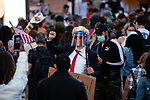 A person dressed as Trump wears a face shield in Times Square as people gather in celebration after former Vice President Joe Biden was declared the winner of the 2020 presidential election between U.S. President Donald Trump and Biden on November 7, 2020 in New York City.  Photograph by Michael Nagle