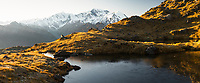 Sunrise on frozen alpine tarns and over highest peaks of Southern Alps, Aoraki Mount Cook, Mount Tasman and La Perouse with Balfour Glacier, Westland Tai Poutini National Park, UNESCO World Heritage Area, West Coast, New Zealand, NZ