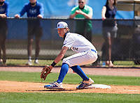 IMG Academy Ascenders first baseman Blaydon Plain (12) stretches for a throw during a game against the Calvary Christian Academy Eagles on March 13, 2021 at IMG Academy in Bradenton, Florida.  (Mike Janes/Four Seam Images)