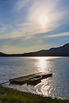 Single boat at dock, at dusk.  Lake Quinault.  Olympic Peninsula,Washington State. Use of this image licensed exclusively by Spaces Images, www.spacesimages.com.