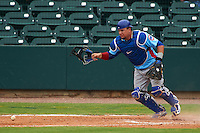 Tennessee Smokies catcher Kyle Schwarber (12) retrieves a blocked pitch in the dirt during a game against the Montgomery Biscuits on May 25, 2015 at Riverwalk Stadium in Montgomery, Alabama.  Tennessee defeated Montgomery 6-3 as the game was called after eight innings due to rain.  (Mike Janes/Four Seam Images)