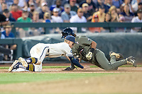 Michigan Wolverines third baseman Blake Nelson (10) tags out Vanderbilt Commodores base runner Austin Martin (16) during the eighth inning of Game 1 of the NCAA College World Series Finals on June 24, 2019 at TD Ameritrade Park in Omaha, Nebraska. Michigan defeated Vanderbilt 7-4. (Andrew Woolley/Four Seam Images)