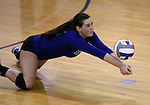 Marymount's Erin Allison gets a dig in a college volleyball game against St. Mary's in Lexington Park, MD, on Wednesday, Oct. 29, 2014. Marymount won 3-2 to go 24-9 on the season.<br /> Photo by Cathleen Allison