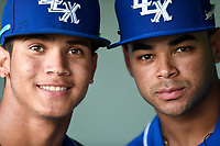 Shortstop Jeison Guzman (11) of the Lexington Legends and Ricky Aracena (2) pose for a photo in the dugout before a game against the Greenville Drive on Saturday, September 1, 2018, at Fluor Field at the West End in Greenville, South Carolina. Greenville won, 9-6. (Tom Priddy/Four Seam Images)