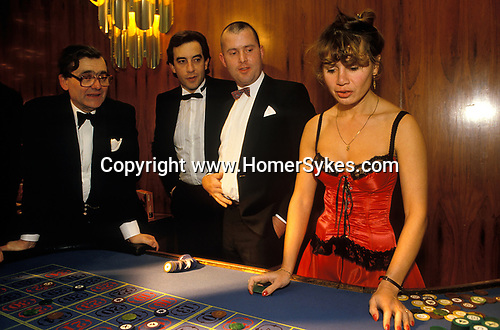 Mayfair, London. 1990's<br /> Three would be high rollers chance their luck at the roulette table at a SPARKS charity fund raising ball at the London Hilton  on Park Lane.