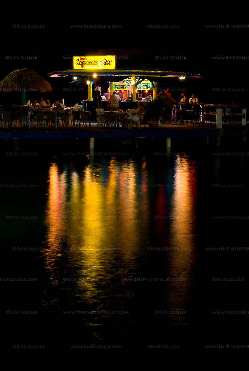 Kralendijk, Bonaire, Netherland Antilles -- The over-water cappuccino bar on Karel's Pier on the Kralendijk waterfront does a steady business most nights.