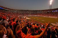 Fans celebrate at the UVa football stadium.