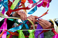 A protester ties a ribbon on the The Ribbon Project during a rally at City Hall prior to the People's Climate March in Seattle, Wash. on October 14, 2015. (photo © Karen Ducey for the Sierra Club)