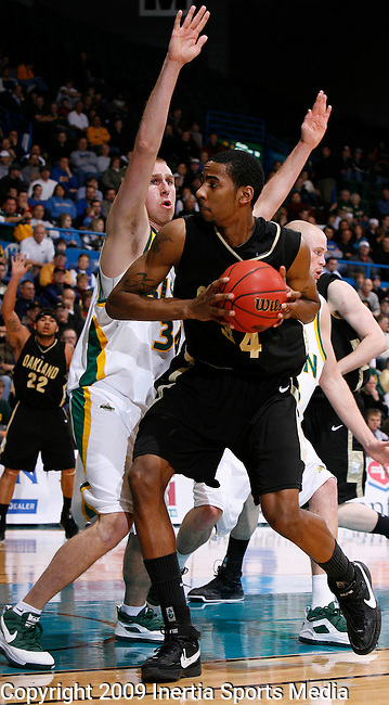 SIOUX FALLS, SD - MARCH 10: Will Hudson #4 of Oakland University drives into pressure from Sam Sussenguth #34 of North Dakota State during the Summit League Tournament men's championship game Tuesday evening at the Sioux Falls Arena. (Photo by Dick Carlson/Inertia)